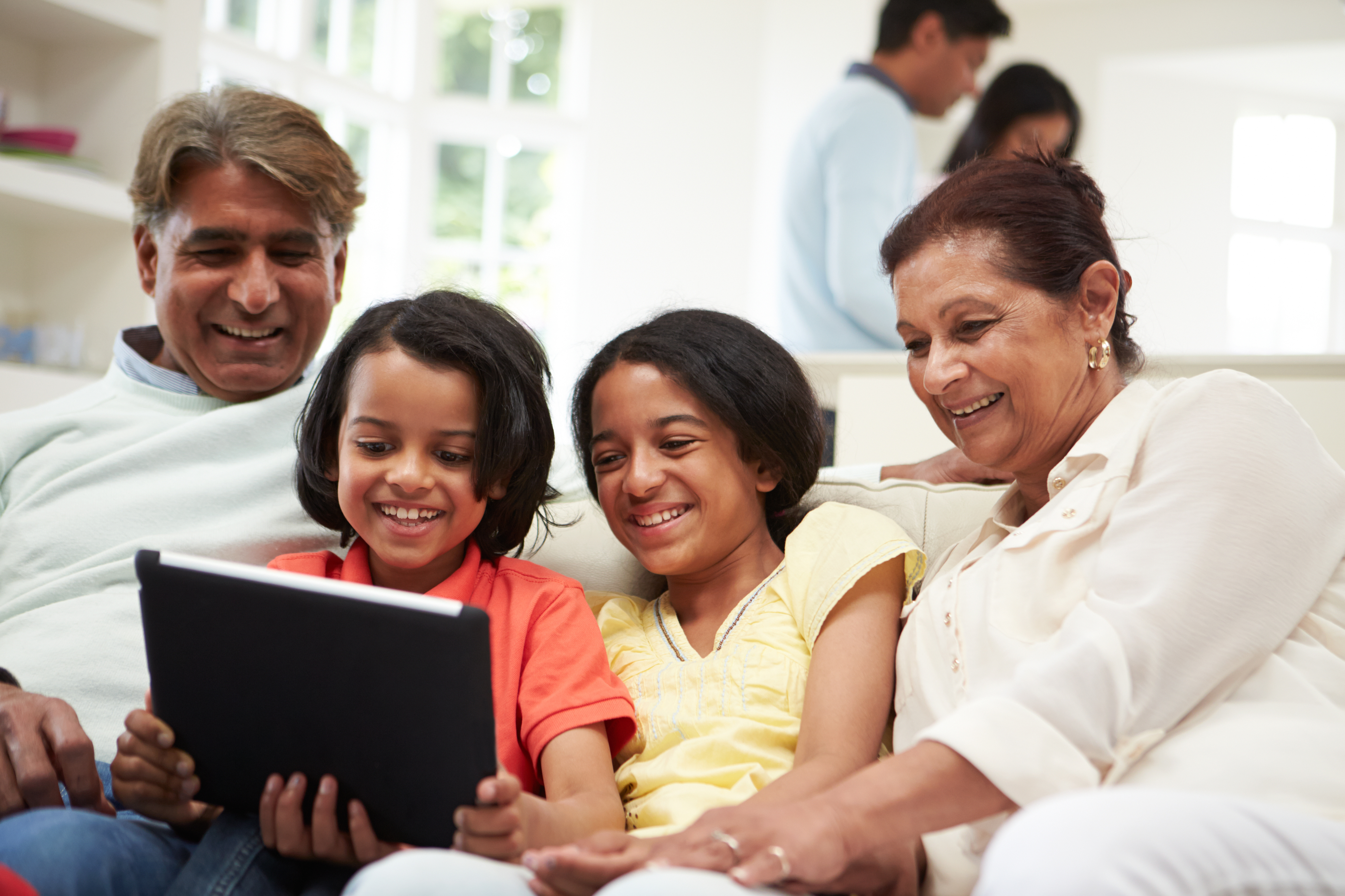 Image: Multi-Generation Indian Family With Digital Tablet